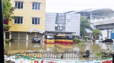 JAKARTA, Indonesia - January 13, 2020: Flooded office buildings and buses in some district at Jakarta city Stok Fotoğraf