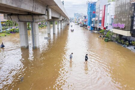 JAKARTA, Indonesia - January 13, 2020: Aerial view of people crossing the flood underneath railways in some district at Jakarta city Stok Fotoğraf