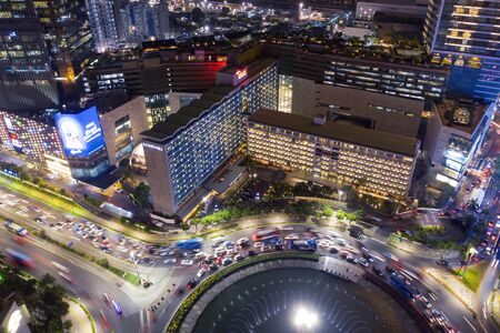 JAKARTA, Indonesia - January 15, 2020: Aerial view of Hotel Indonesia district with traffic jam nearby in Central Jakarta at night