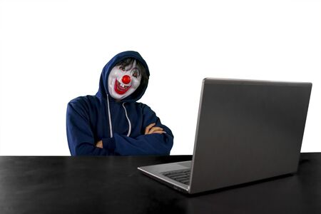 Hacker wearing clown mask with arms folded isolated over white background