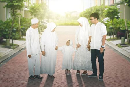 Happy multi-generation muslim family taking a walk in the afternoon
