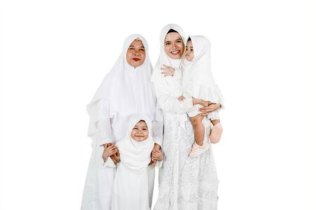 Eid Mubarak celebration concept: Grandmother with daughter and granddaughters isolated over white background