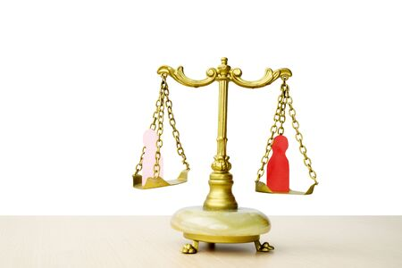 Scales of justice and law on the table, isolated on white background