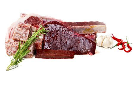 Closeup of fresh raw meat for barbecue with rosemary in the studio. Isolated on white background