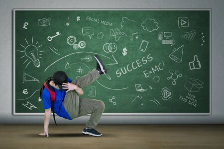Picture of university student doing freestyle with break dance in the classroom