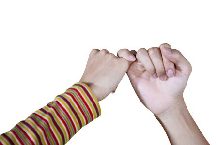 Close up of young couple hands making a pinkie promise, isolated white background
