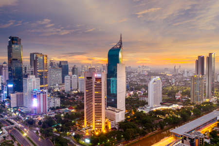 JAKARTA - Indonesia. July 03, 2020: Aerial scenery of Jakarta cityscape on sunrise time with office buildings background