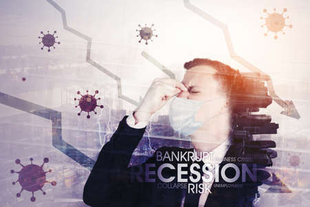 Double exposure of depressed businessman wearing face mask while standing with declining arrow and modern city background