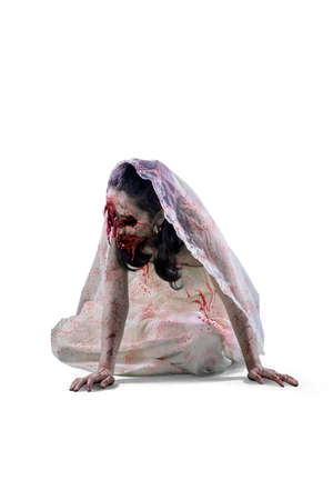 Halloween horror concept. Spooky female bride with wounded face crawling in the studio. Isolated on white background