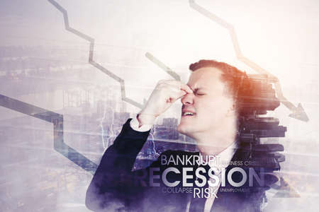 Double exposure of stressed businessman standing with declining arrow and modern city background