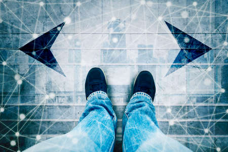 Double exposure of male shoes on left and right arrows with network connection lines on modern city background
