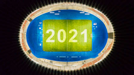 Top view of beautiful football field with number 2021 at night time