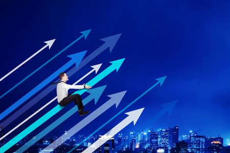 Caucasian businessman riding upward arrow and flying on the night sky with glowing city background