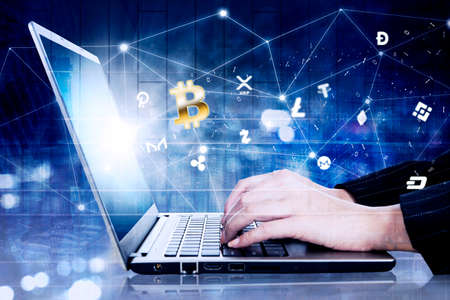Double exposure of businesswoman hands working with a computer laptop while using bitcoin apps with virtual screen background Zdjęcie Seryjne