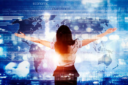 Double exposure of businesswoman stretching her arms while standing with world map on the virtual screen background