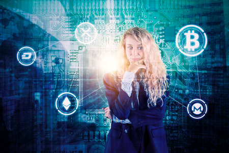Caucasian businesswoman looks pensive while standing with bitcoin symbols in circuit board background. Shot at cyberspace