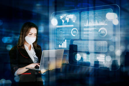 Businesswoman wearing face mask while using a computer laptop with virtual screen background Zdjęcie Seryjne - 164577554