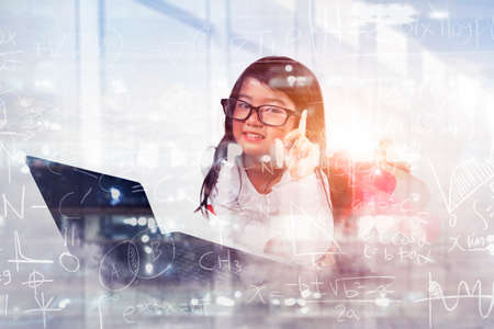 Double exposure of cute female student thinking an idea while using a laptop with doodles background Zdjęcie Seryjne
