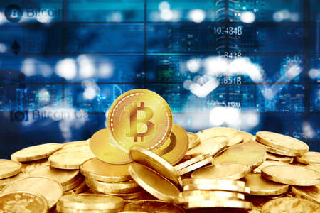Close up of Bitcoin on heap of gold coins with blurred sparkling lights and night city background