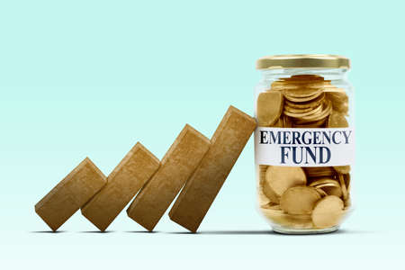 Close up of emergency fund text on glass jar hold back falling financial graph with tosca background Reklamní fotografie