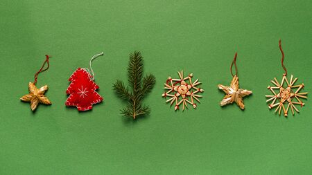 Christmas toys from natural materials fabric tree branches without plastic on a green background. Holiday concept Imagens