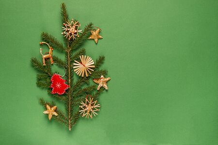 Christmas tree with toys made natural materials without plastic green background. Holiday concept Christmas zero waste. Imagens