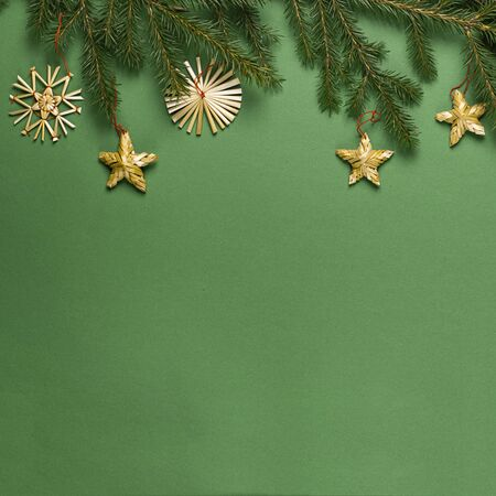Christmas tree branches with toys from natural materials without plastic green background. Christmas concept zero waste.