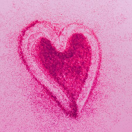 Red heart symbol of love from sparkles pink background. Valentines day cosmetics concept. Square frame copy space.