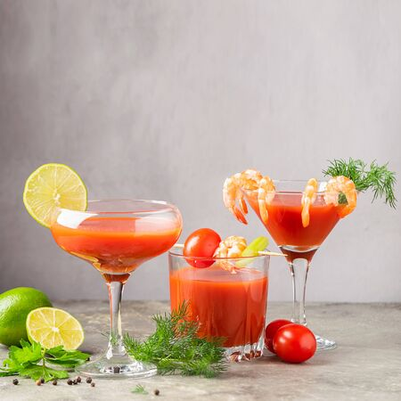 Various cocktails made from tomato juice, shrimp, bloody Mary and the ingredients of tomato, lime, shrimp, celery. 写真素材