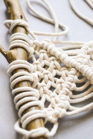 Handmade knitting macrame. Boho lifestyle. Hobby hobby concept. Selective focus vertical frame