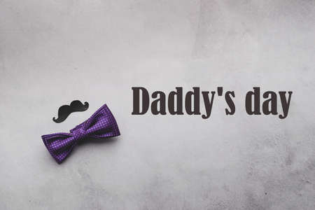 Male tie butterfly black mustache photo props text Pap day on gray background. The concept of mens holiday. Flat layout