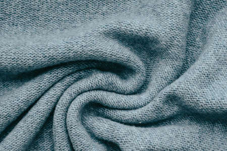 Knitted texture background in trendy gray for wallpapers and backgrounds. Homemade knitting.