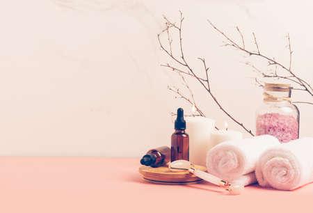 Natural organic cosmetics bottle of oil, cream, clay, salt, massage tool gua sha accessories copy space