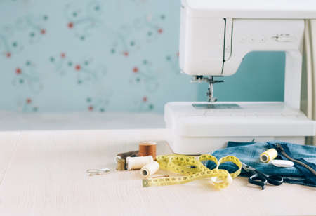 Sewing machine sewing accessories scissors thread buttons for repairing or sewing clothes on a desktop