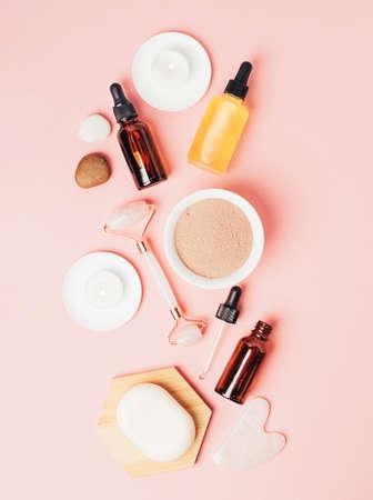 Natural organic cosmetics bottle of oil, cream, clay, salt, massage tool gua sha accessories flat layout copy space