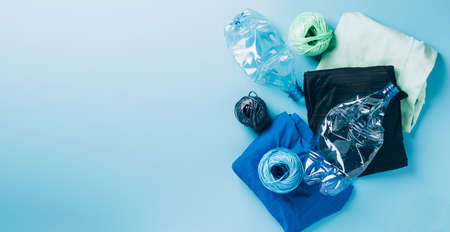 Polyester fiber synthetic fabrics eco-friendly textile recycled recyclable plastic bottles. Reuse recycling used bottles Reklamní fotografie