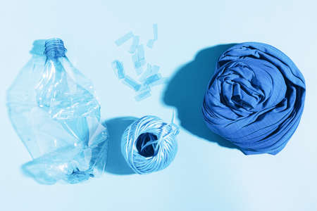 Polyester fiber synthetic fabrics eco-friendly textile recycled recyclable plastic bottles. Reuse recycling used bottles