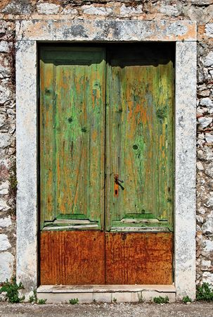 starigrad: Old wooden door with fading paint