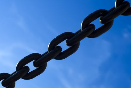 strenght: Short section of a thick steel chain against blue sky Stock Photo