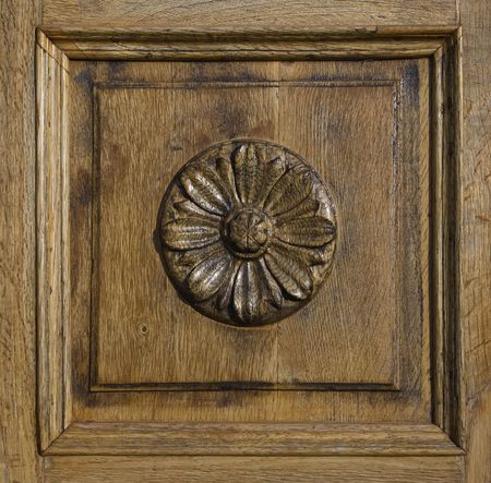 graining: Carved wood panel with floral ornaments