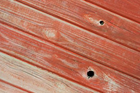 wood panelling: Pine wood panelling with fading red paint