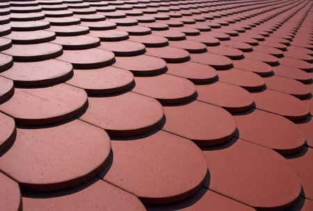 Red tiles of a newly built house photo