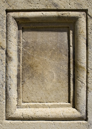 Blank panel chiseled in light grey stone photo