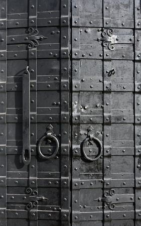 sturdy: Sturdy black door reinforced with iron plates