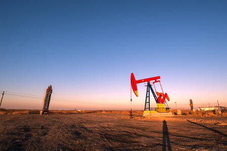 Oil pumps are running at the oil field. Stock Photo
