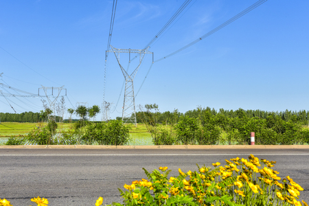 Electric power tower in field