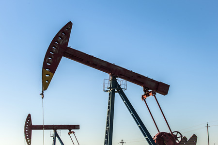 Oil pumps are running at the oil field. 写真素材