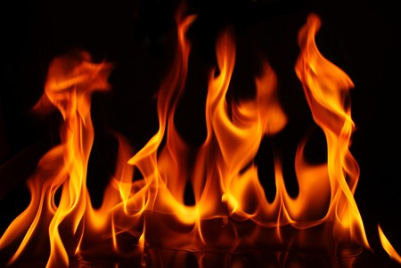 Flame of fire. Orange,black  background Stock Photo