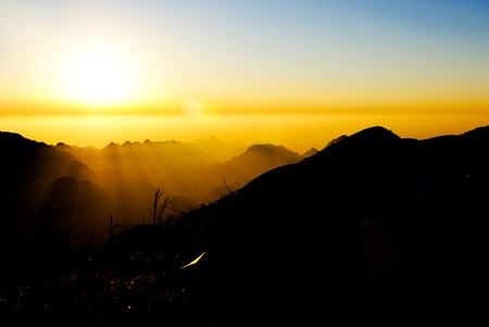 magnificent: Towering mountains and magnificent sunrise
