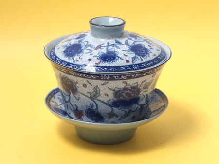 chinese tea cup: blue and   White Cup of tea side view isolated on yellow